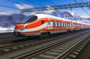 Red modern high speed train passing snowy mountain railroad station with motion blur effect
